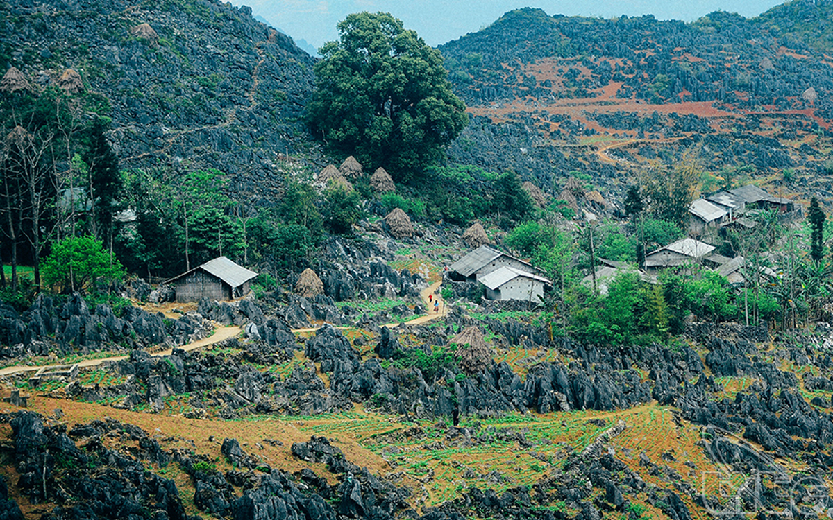 The houses of local ethnic people located among the karst plateau